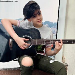 ayaan playing guitar